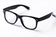Leinwanddruck Bild - Eyeglasses with black rim