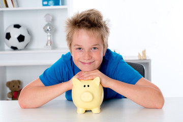 smiling boy with piggy-bank