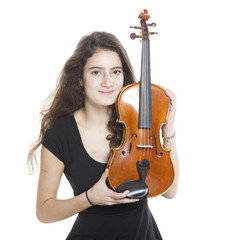 teenage girl holds violin in studio