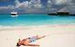 Man is relaxing on a maldivian beach