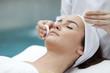 Leinwanddruck Bild - Woman receiving spa treatment