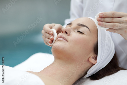 Woman receiving spa treatment  - 75488690