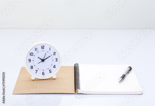 Notebook and office accessories on white background - 75490256