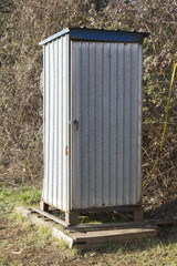 old latrine in the meadow
