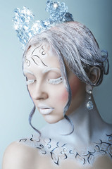 Beauty portrait of girl with snow queen look