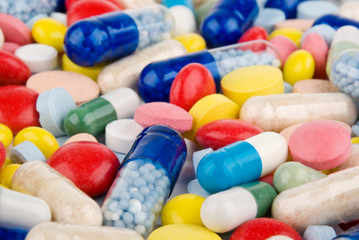 Color pills and capsules background