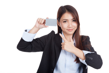 Young Asian businesswoman point to blank card