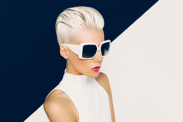 Blonde model in trendy sunglasses with stylish Haircut. Fashion