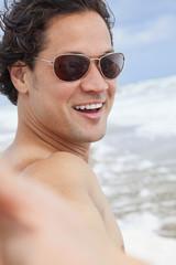 Man at Beach Taking Selfie Photograph