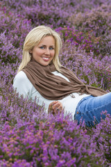 Young Woman Girl in Field of Purple Heather Flowers