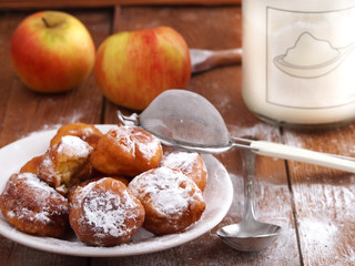 Homemade fritters on wooden background