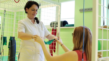 Young girl with doctor during rehabilitation arms