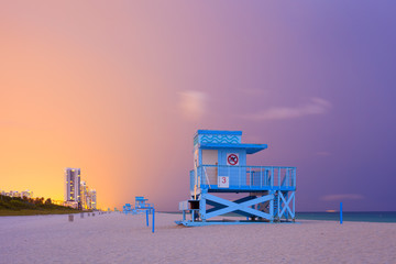Colorful sunset in Miami Beach Florida with lifeguard house