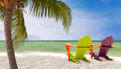 Lounge chairs and palm trees at beach in Miami Florida