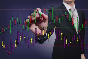 businessman drawing a stock  graph