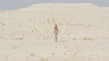 Lure training a falcon in the desert