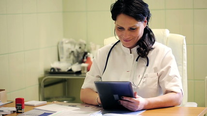 Female doctor working with tablet in the office