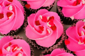 Above view of pink Valentines Day cupcakes