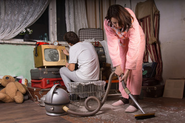 Young Couple Cleaning an Abandoned Room