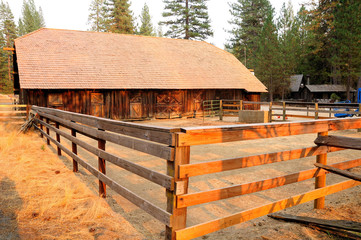 Farm yard enclosed with the wooden fence. California.