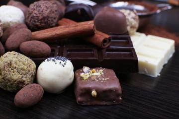 Bars of chocolate and round sweet truffles