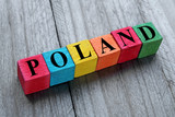 Fototapety word poland on colorful wooden cubes