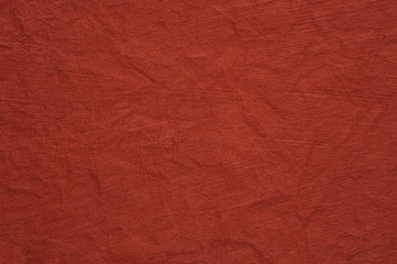 Red crumpled paper as background