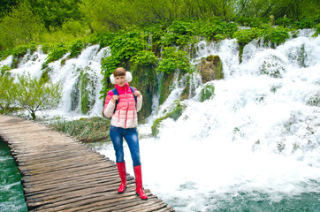 Tourist girl walking in the Plitvice Lakes National Park,