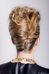 Beautiful woman with evening salon hairstyle