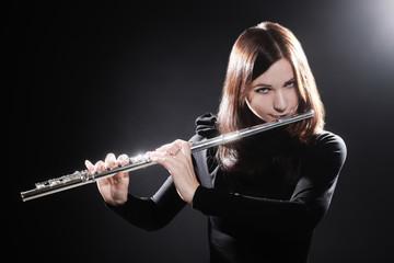 Flutist playing flute music instrument