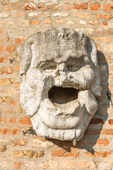A stone mask on wall of Torcello Museum, Torcello, Venice, Italy