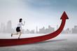 Businesswoman runs on the upward arrow