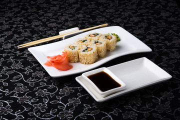 California rolls sushi with pickled ginger, vasabi and soy sauce
