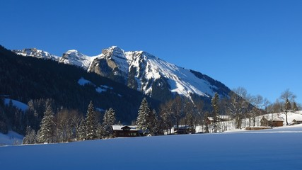 Winter scene in Gsteig bei Gstaad, Swiss Alps