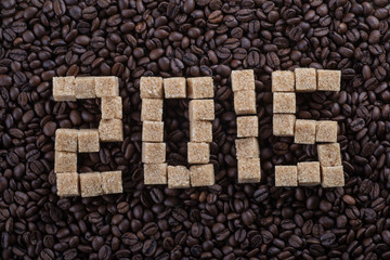 "Roasted coffee beans and sugar inscription text ""2015"""