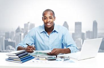 African-American black businessman in office.