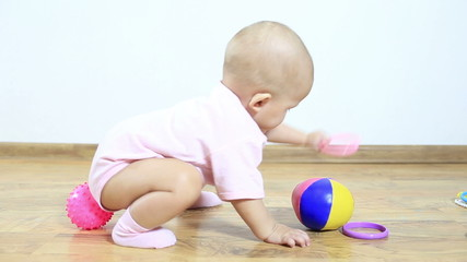 Little Child Play and Crawl on the Floor in the Room