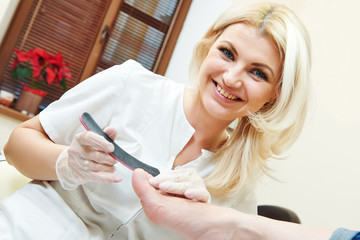 Pedicure specialist in beauty salon