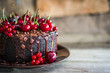 Leinwandbild Motiv Chocolate cake with cherries on wooden background