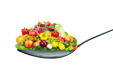Spoon full of various fruit and vegetables