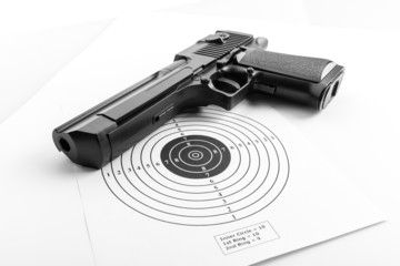Paper target and pistol