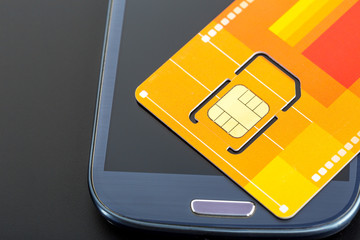 Yellow sim card on the phone