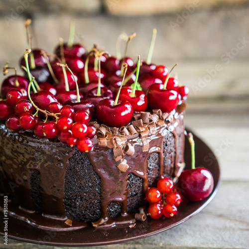 Chocolate cake with cherries on wooden background - 75515053
