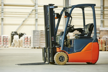 forklift loader stacker truck at warehouse