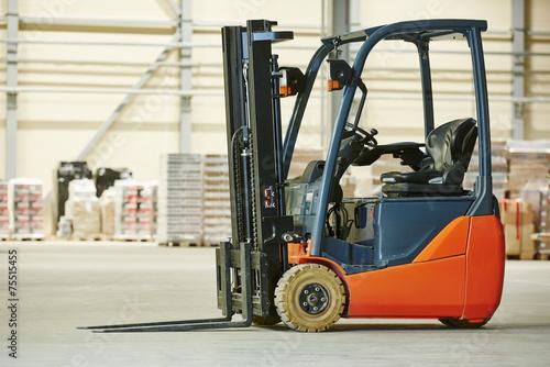 forklift loader stacker truck at warehouse