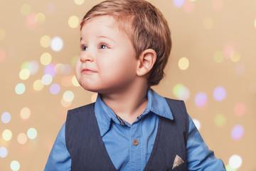 Boy with christmass lights bokeh