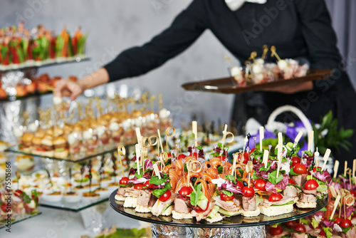 Waiter serving catering table - 75515866