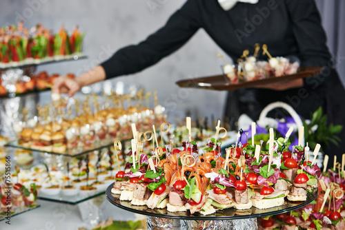 Leinwanddruck Bild Waiter serving catering table