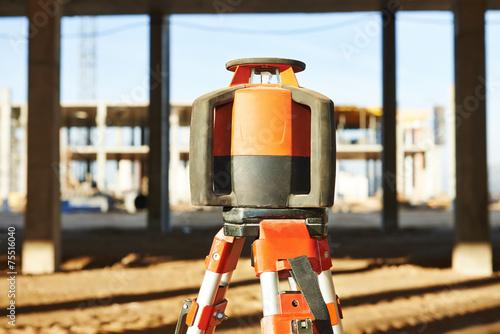 Leinwandbild Motiv laser levelling equipment at construction site