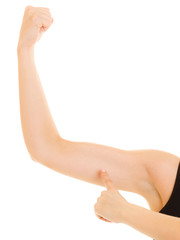 Fitness woman showing energy flexing biceps muscles.